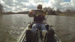 Kayak holding largemouth horizontle