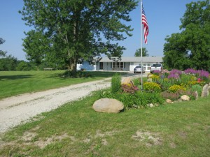 Picture of house for sale in Lucas county Iowa on lake.