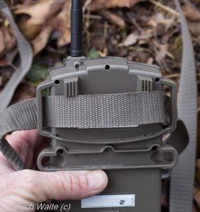 A picture of the Moultrie wireless modem, showing the nylon strap.