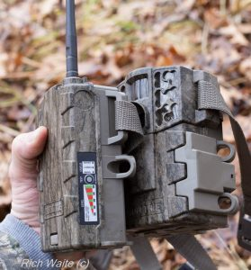 The Moultrie wireless field modem with the Moultrie 888i mini game camera -- all in one hand.